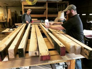 reclaimed chestnut beams being glued